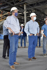 Republicans U.S. Sen. Steve Daines, left, and Rep. Greg Gianforte are seen touring a technology company facility under construction on Wednesday, Sept. 2, 2020 in Bozeman, Mont. Daines is seeking a second term and faces a challenge from Montana Gov. Steve Bullock, while Gianforte faces Lt. Gov. Mike Cooney in the November gubernatorial election. (AP Photo/Matthew Brown)