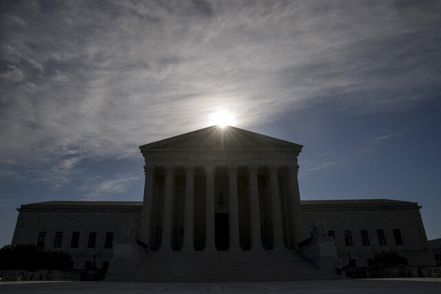 FILE - This May 4, 2020, file photo shows the Supreme Court building in Washington. Controversial Trump administration policies on the census, asylum seekers and the border wall, held illegal by lower courts, are on the Supreme Court's agenda Friday, Oct. 16, 2020. (AP Photo/Andrew Harnik, File)