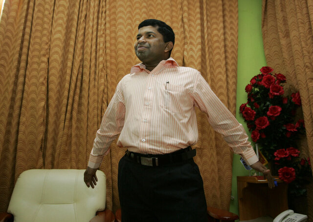 In this Nov. 12, 2009 file photo, Sri Lanka's Eastern Province Chief Minister Sivanesathurai Chandrakanthan is seen at his office in Batticaloa, about 200 kilometers (124 miles) north east of Colombo, Sri Lanka. A Sri Lankan court on Wednesday, Jan.13, 2021 acquitted the rebel-turned-lawmaker of charges that he was involved in the killing of an ethnic Tamil legislator at the height of the island's long civil war. (AP Photo/Eranga Jayawardena, File)