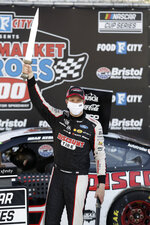 Brad Keselowski (2) celebrates after winning a NASCAR Cup Series auto race at Bristol Motor Speedway Saturday, May 30, 2020, in Bristol, Tenn. (AP Photo/Mark Humphrey)