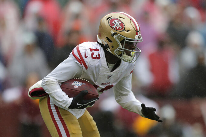 San Francisco 49ers wide receiver Richie James rushes the ball in the second half of an NFL football gameagainst the Washington Redskins, Sunday, Oct. 20, 2019, in Landover, Md. (AP Photo/Julio Cortez)