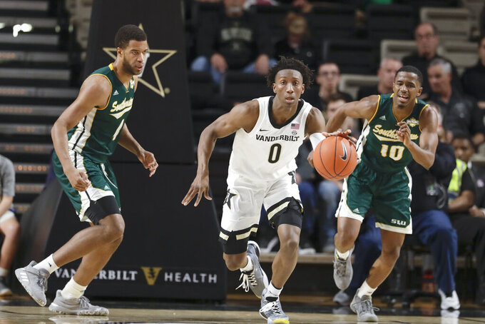 Vanderbilt guard Saben Lee (0) dribbles away from Southeastern Louisiana's Maxwell Starwood, left, and Von Julien (10) in the first half of an NCAA college basketball game Monday, Nov. 25, 2019, in Nashville, Tenn. (AP Photo/Mark Humphrey)