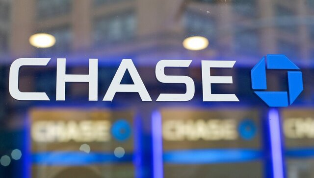 FILE - This Sept. 13, 2014, file photo, shows the Chase bank logo in New York. JPMorgan Chase says profits improved marginally in the third quarter, a notable change after the nation's largest bank had to set aside billions in the last two quarters to cover losses from the coronavirus pandemic. The New York-based bank said it earned a profit of $9.44 billion, or $2.92 a share, in the July to September period.  (AP Photo/Frank Franklin II, File)