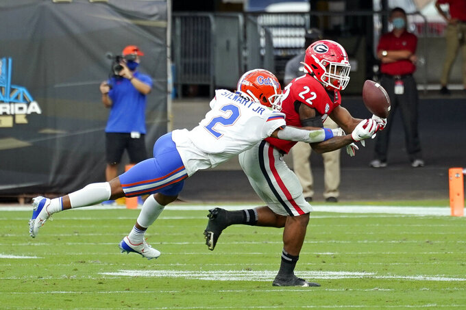 Florida defensive back Brad Stewart Jr. (2) breaks up a pass intended for Georgia running back Kendall Milton (22) during the first half of an NCAA college football game, Saturday, Nov. 7, 2020, in Jacksonville, Fla. (AP Photo/John Raoux)