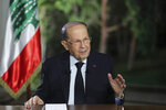 In this photo provided by Lebanon's official government photographer Dalati Nohra, Lebanese President Michel Aoun speaks during a TV interview at the presidential palace, in Baabda, east of Beirut, Lebanon, Tuesday, Nov. 12, 2019. Aoun said it could still take days to set a date for consultations with heads of parliamentary blocs for the naming of a new prime minister and added that the best option is for the new Cabinet to include both politicians and technocrats. (Dalati Nohra via AP)