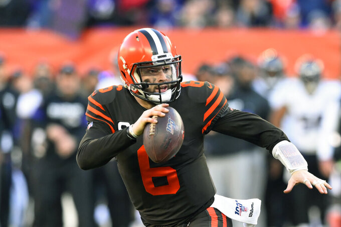 FILE - In this Dec. 22, 2019, file photo, Cleveland Browns quarterback Baker Mayfield scrambles during the second half of an NFL football game against the Baltimore Ravens in Cleveland. Looking back, Browns rookie coach Kevin Stefanski is now thrilled he decided to take a trip to Texas in March to visit Baker Mayfield. During a Zoom conference call on Friday, Aug. 7, 2020, Stefanski revealed that he went to Austin and spent time with Mayfield. (AP Photo/David Richard, File)