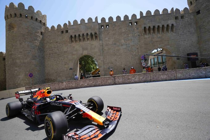 Red Bull driver Sergio Perez of Mexico steers his car during the first free practice at the Baku Formula One city circuit, in Baku, Azerbaijan, Friday, June 4, 2021. The Formula one race will be held on Sunday. (AP Photo/Darko Vojinovic)