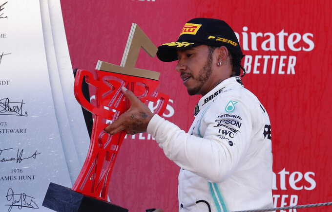 Mercedes driver Lewis Hamilton of Britain celebrates on the podium after winning the Spanish Formula One race at the Barcelona Catalunya racetrack in Montmelo, just outside Barcelona, Spain, Sunday, May 12, 2019. (AP Photo/Manu Fernandez)