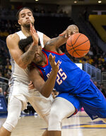 Marquette forward Theo John, left, fouls DePaul forward Femi Olujobi during the second half of an NCAA college basketball game, Wednesday, Jan. 23, 2019, in Milwaukee. (AP Photo/Darren Hauck)2