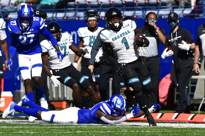 Coastal Carolina running back CJ Marable gets past a Georgia State defender during the second half of an NCAA football game Saturday, Oct. 31, 2020, in Atlanta. Coastal Carolina won 51-0. (AP Photo/John Amis)