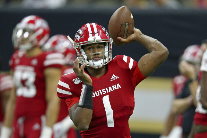 Louisiana-Lafayette Ragin Cajuns quarterback Levi Lewis (1) warms up before their NCAA football game against the Mississippi State Bulldogs in New Orleans, Saturday, Aug. 31, 2019. (AP Photo/Chuck Cook)