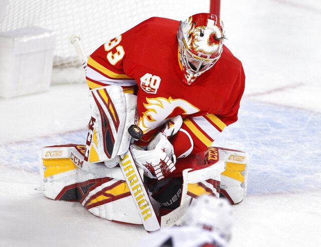Calgary Flames goalie David Rittich, of the Czech Republic, makes a save against the Ottawa Senators during the second period of an NHL hockey game Saturday, Nov, 30, 2019, in Calgary, Alberta. (Larry MacDougal/The Canadian Press via AP)