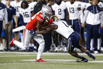 Ohio State running back TreVeyon Henderson, left, is tackled by Akron defensive back Randy Cochran during the first half of an NCAA college football game Saturday, Sept. 25, 2021, in Columbus, Ohio. (AP Photo/Jay LaPrete)