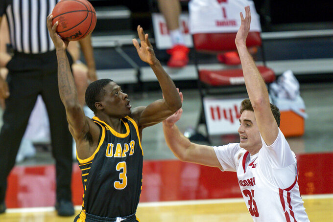 Arkansas-Pine Bluff's Markedric Bell (3) shoots against Wisconsin's Nate Reuvers (35) during the first half of an NCAA college basketball game Friday, Nov. 27, 2020, in Madison, Wis. (AP Photo/Andy Manis)