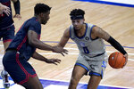 Saint Louis' Jordan Goodwin (0) heads to the basket as Dayton's Moulaye Sissoko defends during the second half of an NCAA college basketball game Tuesday, Jan. 26, 2021, in St. Louis. (AP Photo/Jeff Roberson)