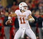 Texas' Sam Ehlinger (11) looks to pass the ball during the first half of an NCAA college football game against Texas Tech, Saturday, Nov. 10, 2018, in Lubbock, Texas. (AP Photo/Brad Tollefson)