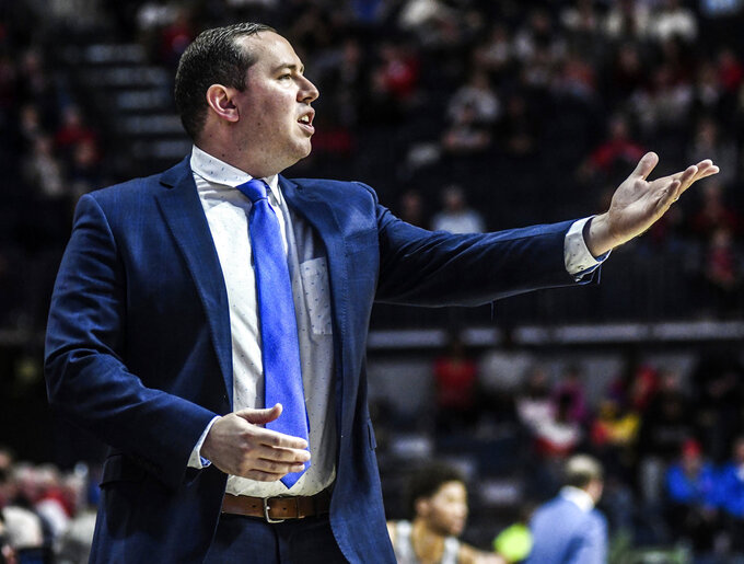 Florida Gulf Coast head coach Michael Fly questions an official during an NCAA college basketball game against Mississippi Saturday, Dec. 29, 2018, in Oxford, Miss. (Bruce Newman/Oxford Eagle via AP)
