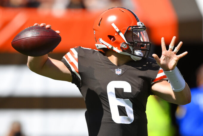 Cleveland Browns quarterback Baker Mayfield throws during the first half of an NFL football game against the Houston Texans, Sunday, Sept. 19, 2021, in Cleveland. (AP Photo/David Richard)