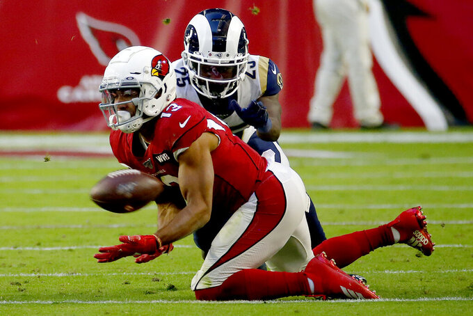 Arizona Cardinals wide receiver Christian Kirk (13) makes a catch as Los Angeles Rams defensive back David Long (25) defends during the second half of an NFL football game, Sunday, Dec. 1, 2019, in Glendale, Ariz. (AP Photo/Rick Scuteri)