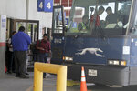 FILE - In this April 2, 2019, file photo an asylum seeker from Guatemala boards a Greyhound bus in El Paso, Texas. A Customs and Border Protection memo dated Jan. 28, 2020, obtained by The Associated Press confirms that bus companies such as Greyhound do not have to allow Border Patrol agents on board to conduct routine checks for illegal immigrants, despite the company's insistence that it has no choice but to do so. (AP Photo/Cedar Attanasio, File)
