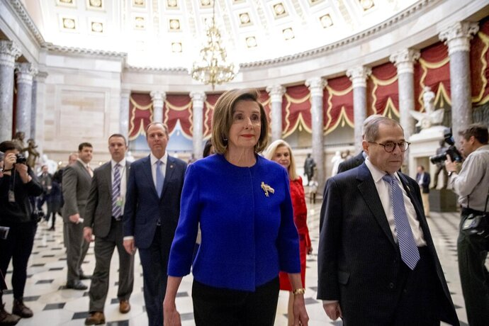 House Speaker Nancy Pelosi of Calif., with from left, Adam Schiff, D-Calif., Chairman of the House Intelligence Committee, Chairwoman of the House Oversight and Reform Committee Carolyn Maloney, D-N.Y., and Chairman of the House Judiciary Committee Jerrold Nadler, D-N.Y., walk to a news conference to unveil articles of impeachment against President Donald Trump, abuse of power and obstruction of Congress, Tuesday, Dec. 10, 2019, on Capitol Hill in Washington. (AP Photo/Andrew Harnik)