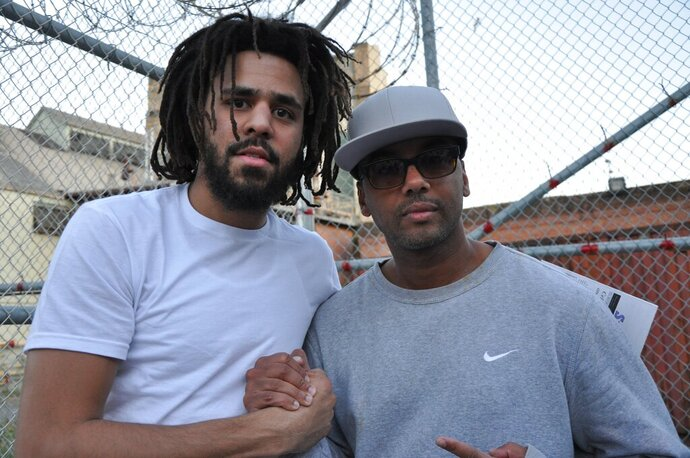 """This undated image shows music artist J Cole, left, with incarcerated Swedish music producer David Jassy at San Quentin State Prison in California. Jassy, whose sentence was commuted by California Gov. Gavin Newsom this year, produced an album """"San Quentin Mixtape, Vol. 1,"""