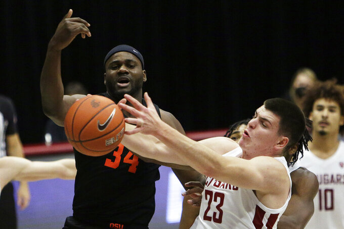 Oregon State forward Rodrigue Andela (34) and Washington State forward Andrej Jakimovski (23) go after a rebound during the second half of an NCAA college basketball game in Pullman, Wash., Wednesday, Dec. 2, 2020. Washington State won 59-55. (AP Photo/Young Kwak)
