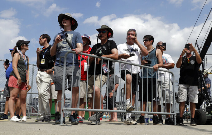 NASCAR fans watch during the NASCAR Xfinity Series auto race at Chicagoland Speedway in Joliet, Ill., Saturday, June 29, 2018. (AP Photo/Nam Y. Huh)