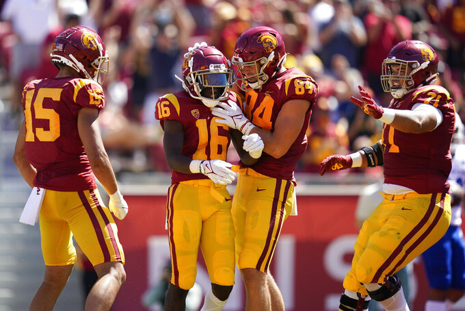 Southern California wide receiver Tahj Washington (16) celebrates with tight end Erik Krommenhoek (84) after catching a pass in the end zone for a touchdown during the first half of an NCAA college football game against San Jose State Saturday, Sept. 4, 2021, in Los Angeles. (AP Photo/Ashley Landis)