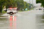 A Freeport Police Department vehicle drives down a flooded S. Velasco Blvd. between west Fifth and Seventh streets, Wednesday, Sept. 18, 2019, in Freeport, Texas, as heavy rain from Tropical Depression Imelda falls. (Mark Mulligan/Houston Chronicle via AP)