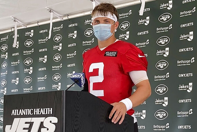 New York Jets rookie quarterback Zach Wilson speaks to reporters after his first practice at the NFL football team's training camp in Florham Park, N.J., Friday, July 30, 2021. (AP Photo/Dennis Waszak Jr.)