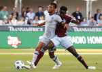 Colorado Rapids forward Dominique Badji, right, competes for control of the ball with Chicago Fire defender Johan Kappelhof during the first half of an MLS soccer match Wednesday, June 13, 2018, in Commerce City, Colo. (AP Photo/David Zalubowski)