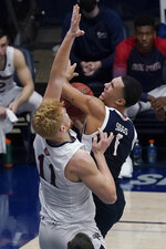 Gonzaga guard Jalen Suggs (1) shoots against Saint Mary's forward Matthias Tass (11) during the first half of an NCAA college basketball game in Moraga, Calif., Saturday, Jan. 16, 2021. (AP Photo/Jeff Chiu)