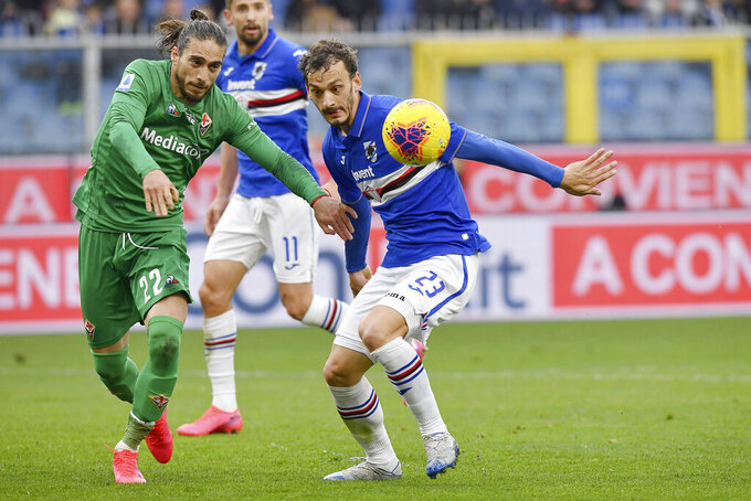 Fiorentina's Martin Caceres, left vies for the ball with Sampdoria's Manolo Gabbiadini during a Serie A soccer match between Fiorentina and Sampdoria at the Luigi Ferraris Stadium in Genoa, Italy, Sunday, Feb. 16, 2020. (Tano Pecoraro/Lapresse via AP)