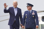 President Joe Biden walks with Col. Matthew E. Jones, Commander of the 89th Airlift Wing, to board Air Force One at Andrews Air Force Base, Md., Wednesday, July 21, 2021, to travel to Cincinnati for a town hall and to tour an electrical training center. (AP Photo/Andrew Harnik)