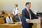 Michelle Carter, 22, second left, appears in Taunton District Court in Taunton, Mass. Monday, February 11, 2019 for a hearing on her prison sentence as lawyer Joe Cataldo speaks at the podium. Carter was convicted in 2017 of involuntary manslaughter and sentenced to a 15-month prison term for encouraging 18-year-old Conrad Roy, III to kill himself when she instructed him over the phone to get back in his truck that was filling with toxic gas in July 2014. Her sentence was put on hold while the court reviewed the case and the defense argument that her actions were not criminal. Carter's conviction was upheld. (Mark Stockwell/The Sun Chronicle via AP, Pool)