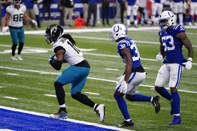 Jacksonville Jaguars' Laviska Shenault Jr. (10) makes a touchdown reception against Indianapolis Colts' T.J. Carrie (38) during the first half of an NFL football game, Sunday, Jan. 3, 2021, in Indianapolis. (AP Photo/AJ Mast)