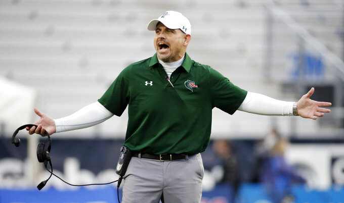UAB head coach Bill Clark argues a call in the second half of the NCAA Conference USA championship college football game against Middle Tennessee Saturday, Dec. 1, 2018, in Murfreesboro, Tenn. (AP Photo/Mark Humphrey)