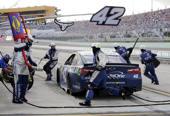 Kyle Larson makes a pit stop during the NASCAR Cup Series championship auto race at Homestead-Miami Speedway, Sunday, Nov. 18, 2018, in Homestead, Fla. (AP Photo/Terry Renna)