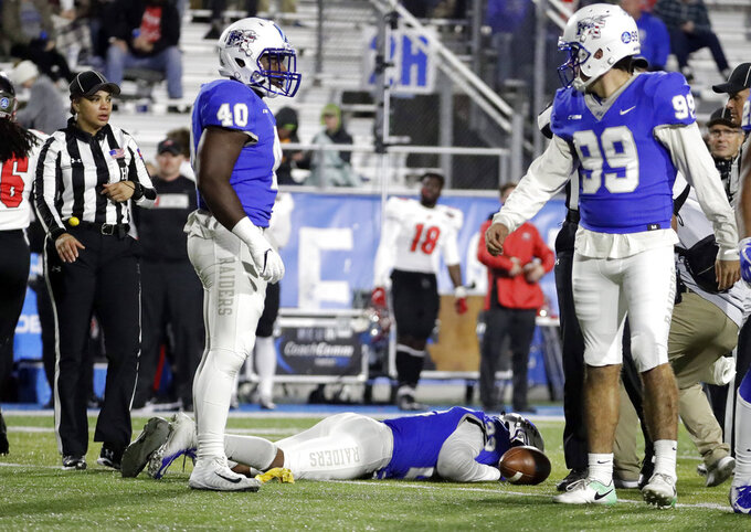 Middle Tennessee defensive back Cordell Hudson (22) lies on the field after being injured during the second half of the team's NCAA college football game against Western Kentucky on Friday, Nov. 2, 2018, in Murfreesboro, Tenn. Middle Tennessee won 29-10. (AP Photo/Mark Humphrey)