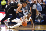 Connecticut's Brendan Adams dives and picks off the ball from Central Florida's Dazon Ingram, left, in the second half of an NCAA college basketball game, Wednesday, Feb. 26, 2020, in Hartford, Conn. (AP Photo/Jessica Hill)