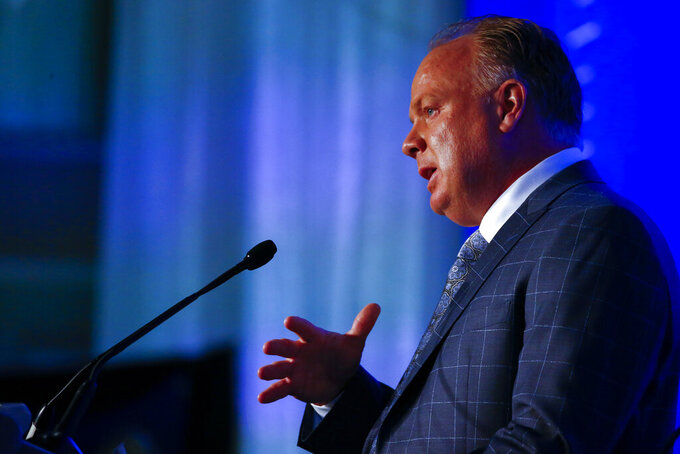 Kentucky head coach Mark Stoops speaks to reporters during the NCAA college football Southeastern Conference Media Days, Thursday, July 18, 2019, in Hoover, Ala. (AP Photo/Butch Dill)