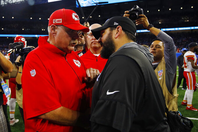 Kansas City Chiefs head coach Andy Reid, left, meets with Detroit Lions head coach Matt Patricia after an NFL football game, Sunday, Sept. 29, 2019, in Detroit. Kansas City won 34-30. (AP Photo/Rick Osentoski)