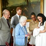 In this image made available by SussexRoyal on Wednesday May 8, 2019, Britain's Prince Harry and Meghan, Duchess of Sussex, joined by her mother Doria Ragland, show their new son to Queen Elizabeth II and Prince Philip at Windsor Castle, Windsor, England. Prince Harry and Meghan have named their son Archie Harrison Mountbatten-Windsor. (Chris Allerton/SussexRoyal via AP)