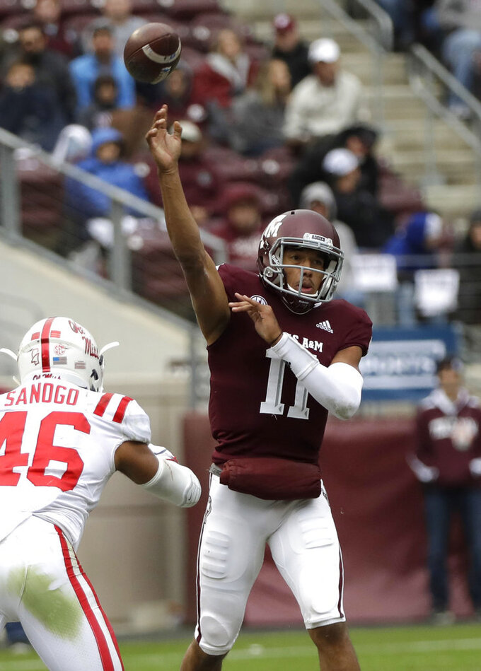 Texas A&M quarterback Kellen Mond (11) throws a pass as Mississippi Rebels linebacker Mohamed Sanogo (46) defends during the first half of an NCAA college football game Saturday, Nov. 10, 2018, in College Station, Texas. (AP Photo/David J. Phillip)