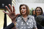 Speaker of the House Nancy Pelosi, D-Calif., left, speaks with media members with Rep. Suzan DelBene, D-Wash., after they spoke about lowering the cost of prescription drug prices Tuesday, Oct. 8, 2019, at Harborview Medical Center in Seattle. (AP Photo/Elaine Thompson)
