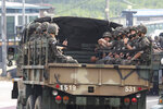 South Korean army soldiers ride on the back of a truck in Paju, near the border with North Korea, South Korea, Wednesday, June 17, 2020. North Korea said Wednesday it will redeploy troops to now-shuttered inter-Korean tourism and economic sites near the border with South Korea and take other steps to nullify landmark 2018 tension-reduction deals. (AP Photo/Ahn Young-joon)