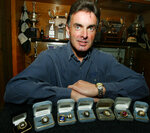 FILE - In this April 22, 2003, file photo, former stock car driver Mike Stefanik poses with his championship rings in front of a trophy case in his Coventry, R.I. home. Stefanik is a contender for NASCAR's 2021 Hall of Fame class, to be announced Tuesday, June 16, 2020. (AP Photo/Joe Giblin, File)