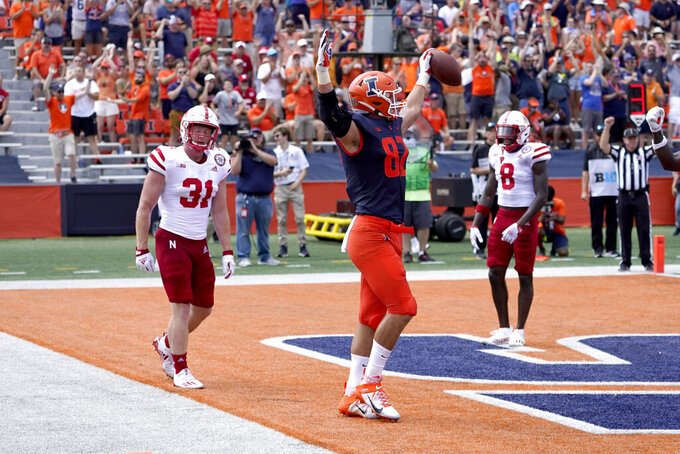 Illinois tight end Luke Ford celebrates his touchdown as Nebraska linebacker Chris Kolarevic (31) and safety Deontai Williams watch during the second half of an NCAA college football game Saturday, Aug. 28, 2021, in Champaign, Ill. Illinois won 30-22. (AP Photo/Charles Rex Arbogast)