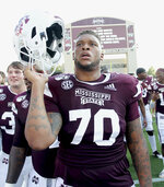 Mississippi State offensive lineman Tommy Champion (70) sings the Mississippi State alma mater after after defeating Southern Miss. 38-15 in an NCAA college football game Saturday, Sept. 7, 2019, in Starkville, Miss. (AP Photo/Jim Lytle)
